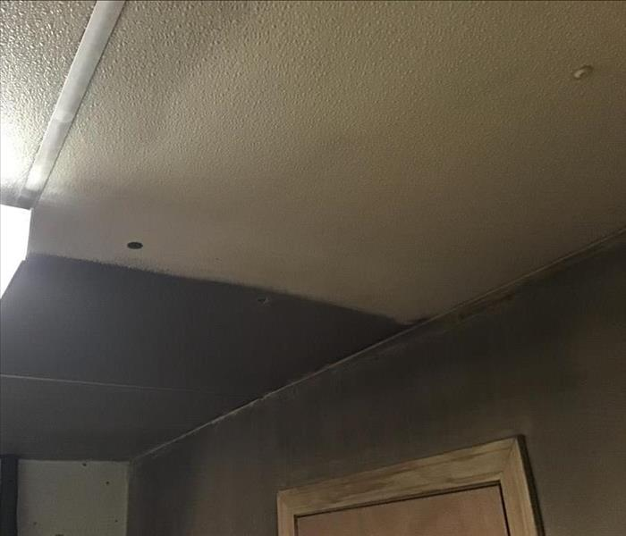 Partially restored ceiling after soot damage.