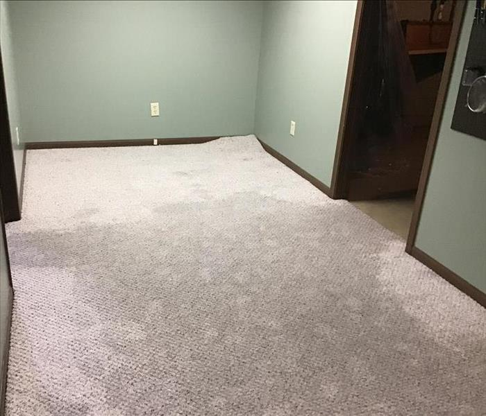 Carpeted floor full of water
