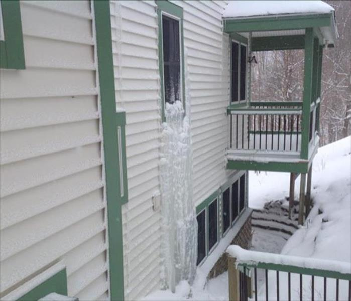 Ice Formation Outside Window of Residential Home